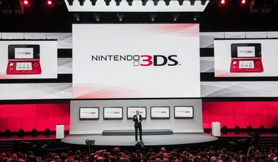 "FILE - In this June 5, 2012 file photo, Scott Moffitt, executive vice president of sales and marketing for Nintendo of America, presents Nintendo 3DS at the Nintendo All-Access presentation at the E3 2012 in Los Angeles. The gaming company said Tuesday, May 6, 2014, it wouldn't bow to pressure to allow players to engage in romantic entanglements with characters of the same sex in the English version of ""Tomodachi Life"" following a social media campaign launched last month seeking virtual equality for the game's characters, which are modeled after real people. (AP Photo/Damian Dovarganes, file)"