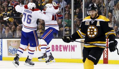 10ThingstoSeeSports - Montreal Canadiens defenseman Francis Bouillon jumps with defenseman P.K. Subban (76) to celebrate his goal as Boston Bruins center David Krejci, right, skates away during the third period in Game 1 of an NHL hockey second-round playoff series in Boston, Thursday, May 1, 2014. (AP Photo/Elise Amendola, File)
