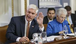 """House Rules Committee Chairman Pete Sessions, R-Texas, joined at right by Rep. Virginia Foxx, R-N.C., responds to a point from Democrats on the panel as lawmakers work on the creation of a special select committee to investigate the 2012 attack on the U.S. diplomatic outpost in Benghazi, Libya, that killed the ambassador and three other Americans, at the Capitol in Washington, Wednesday, May 7, 2014. House Republicans on Wednesday moved toward an election-year special investigation of the deadly attack, brushing aside Democratic concerns over the panel's scope and composition. The Obama administration, meanwhile, accused Republicans of """"political motivation"""" after they issued a fundraising email linked to the Benghazi probe. (AP Photo/J. Scott Applewhite)"""