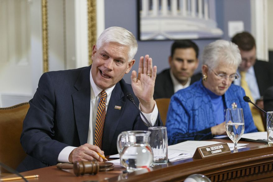 "House Rules Committee Chairman Pete Sessions, R-Texas, joined at right by Rep. Virginia Foxx, R-N.C., responds to a point from Democrats on the panel as lawmakers work on the creation of a special select committee to investigate the 2012 attack on the U.S. diplomatic outpost in Benghazi, Libya, that killed the ambassador and three other Americans, at the Capitol in Washington, Wednesday, May 7, 2014. House Republicans on Wednesday moved toward an election-year special investigation of the deadly attack, brushing aside Democratic concerns over the panel's scope and composition. The Obama administration, meanwhile, accused Republicans of ""political motivation"" after they issued a fundraising email linked to the Benghazi probe. (AP Photo/J. Scott Applewhite)"