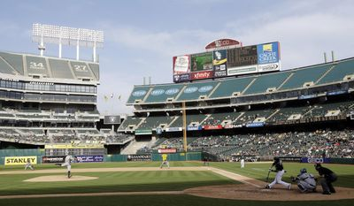 Seattle Mariners starting pitcher Erasmo Ramirez, left, pitches to Oakland Athletics' Jed Lowrie during the fifth inning of a baseball game on Wednesday, May 7, 2014, in Oakland, Calif. (AP Photo/Marcio Jose Sanchez)