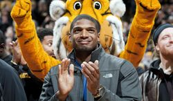 FILE - In this Feb. 15, 2014, file photo, Missouri's All-American defensive end Michael Sam claps during the Cotton Bowl trophy presentation at halftime of an NCAA college basketball game between Missouri and Tennessee in Columbia, Mo.  Sam has been selected the winner of the Arthur Ashe Courage Award. The Missouri defensive end who likely will be drafted by an NFL team this weekend, will receive the award given to individuals who transcend sports at The 2014 ESPYs on July 16. (AP Photo/L.G. Patterson, File)