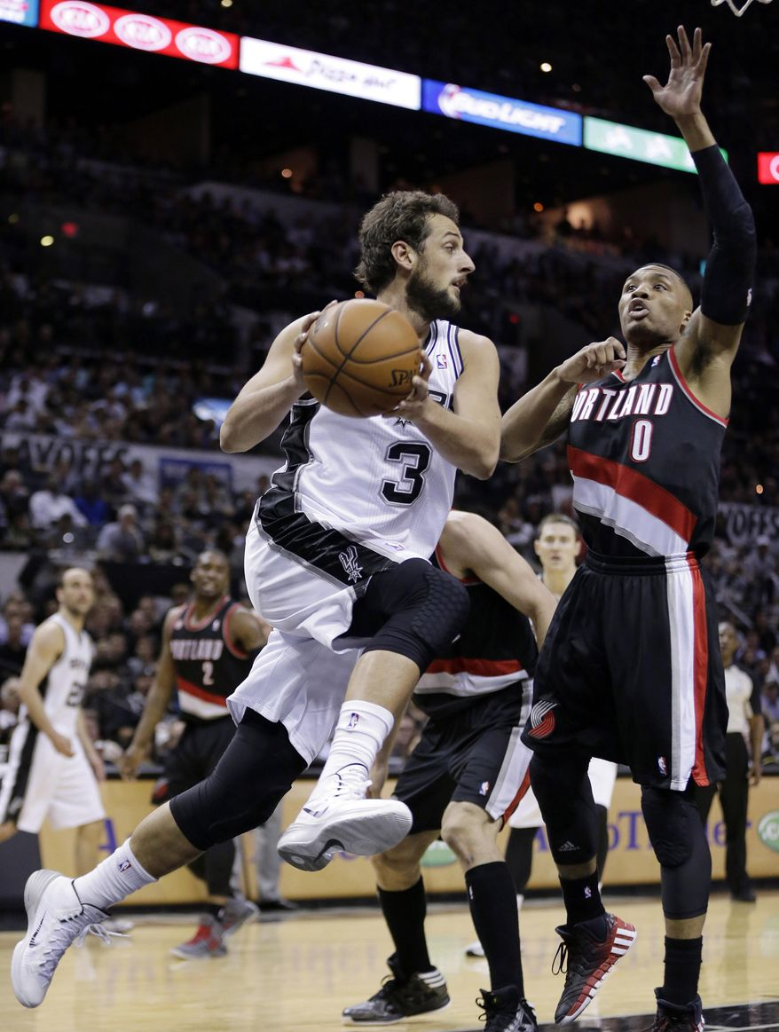 San Antonio Spurs' Marco Belinelli (3), of Italy, drives around Portland Trail Blazers' Damian Lillard (0) during the first half of Game 1 of a Western Conference semifinal NBA basketball playoff series, Tuesday, May 6, 2014, in San Antonio. (AP Photo/Eric Gay)