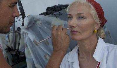 "In this April 24, 2014 photo, actor Joely Richardson sits down to have her makeup applied during the shooting of the movie ""Papa"" in Havana Bay, Cuba. An international film crew has been re-enacting this and other historic scenes from the 1950s in the streets of Havana in recent weeks for ""Papa,"" a biopic about the budding friendship between Hemingway and a young journalist in turbulent, pre-revolution Cuba. (AP Photo/Yesica Fish)"