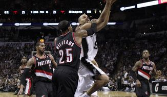 San Antonio Spurs' Tony Parker (9), of France, is fouled by Portland Trail Blazers' Mo Williams (25) during the second half of Game 1 of a Western Conference semifinal NBA basketball playoff series, Tuesday, May 6, 2014, in San Antonio. (AP Photo/Eric Gay)