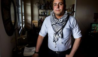 In this Sunday, May 4, 2014 photo, Bashar Makhay stands for a photo in his apartment in the Brooklyn borough of New York. Makhay, who is Iraqi-American, Catholic and gay, said he created Tarab, a series of parties, beach gatherings and other events for LGBT Arabs and Middle Easterners in New York City. The Tarab program will celebrate its second anniversary with an event May 10. (AP Photo/Craig Ruttle)