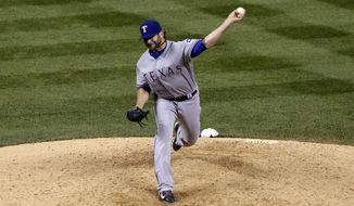 Texas Rangers outfielder Mitch Moreland fills in as a relief pitcher against the Colorado Rockies in the eighth inning of an interleague baseball game in Denver on Tuesday, May 6, 2014. (AP Photo/David Zalubowski)