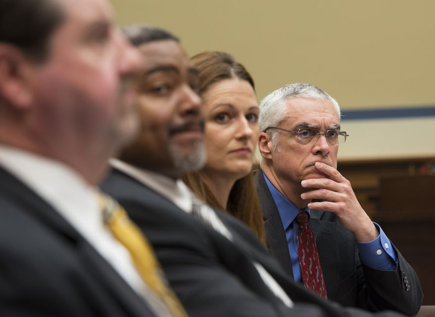 Bob Perciasepe, right, EPA's deputy administrator, listens to testimony before the House Oversight and Government Reform full committee hearing, Wednesday, May 7, 2014 in Washington. Also seated are from left, Patrick Sullivan, Assistant Inspector General for Investigations, Office of Inspector General, EPA, Allan Williams, Deputy Assistant Inspector General for Investigations, Office of Inspector General, EPA, Elisabeth Heller Drake, Special Agent, Office of Investigations, Office of Inspector General, EPA. (AP Photo/Molly Riley)