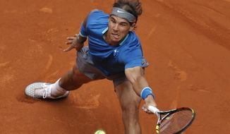 Rafael Nadal from Spain returns the ball during a Madrid Open tennis tournament match against Juan Monaco from Argentina, in Madrid, Spain, Wednesday, May 7, 2014. (AP Photo/Andres Kudacki)