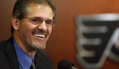 New Philadelphia Flyers general manager Ron Hextall laughs during an NHL hockey news conference, Wednesday, May 7, 2014, in Philadelphia. Hextall is Philadelphia's all-time winningest goalie and served as assistant GM last year before being promoted. He replaces Paul Holmgren who was elevated to president. (AP Photo/Matt Slocum)