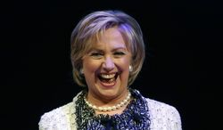 Former Secretary of State Hillary Rodham Clinton smiles as she walks on stage during the Philanthropy New York's annual meeting, Wednesday, May 7, 2014, at the Ford Foundation in New York. Clinton was interviewed by television journalist Robin Roberts during the event. (AP Photo/Julio Cortez)