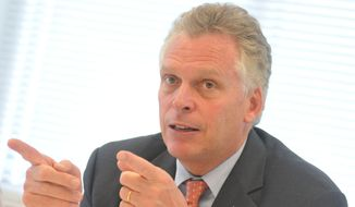 ** FILE ** Virginia Gov. Terry McAuliffe gestures during a discussion with staff and patients of the Hopewell-Prince George Community Health Center Wednesday, May 7, 2014, in Prince George County, Va. McAuliffe is rallying support for expanding Medicaid for 400,000 Virginians, a plan opposed by the House of Delegates. (AP Photo/The Progress-Index, Patrick Kane)