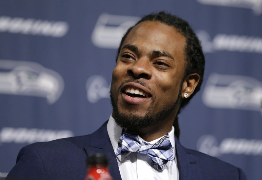 Seattle Seahawks' Richard Sherman addresses a news conference Wednesday, May 7, 2014, at the team's headquarters in Renton, Wash. Sherman signed a four-year contract extension Wednesday with the Seahawks, a deal that makes him one of the highest-paid cornerbacks in NFL history. (AP Photo/Elaine Thompson)