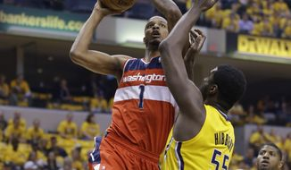 Washington Wizards forward Trevor Ariza (1) shoots over Indiana Pacers center Roy Hibbert during the first quarter of game 1 of the Eastern Conference semifinal NBA basketball playoff series in Indianapolis, Monday, May 5, 2014(AP Photo/Michael Conroy)