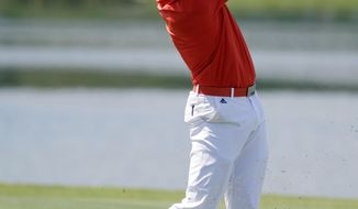 Sergio Garcia of Spain, hits from the 18th fairway during the first round of The Players championship golf tournament at TPC Sawgrass, Thursday, May 8, 2014 in Ponte Vedra Beach, Fla. (AP Photo/John Raoux)