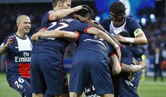 Paris Saint-Germain's players celebrate the opening goal during a French league one soccer match between Paris-Saint-Germain and Rennes at Parc des Princes stadium in Paris, Wednesday, May 7, 2014. Paris Saint Germain clinched their second straight French league title on Wednesday after rival Monaco drew 1-1 against French Cup holder Guingamp. (AP Photo/Michel Euler)