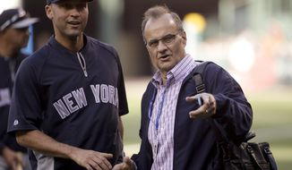 Former Yankees manager Joe Torre, right, and  New York Yankees' Derek Jeter chat during batting practice before a baseball game against the Los Angeles Angels in Anaheim, Calif., Monday, May 5, 2014. (AP Photo/Chris Carlson)
