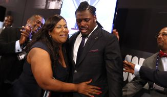 Jadeveon Clowney, from South Carolina, reacts with his mother Josenna Clowney after being selected first overall by the Houston Texans in the first round of the NFL football draft, Thursday, May 8, 2014, at Radio City Music Hall in New York. (AP Photo/Jason DeCrow)