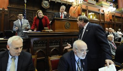 Connecticut Speaker of the House Brendan Sharkey, at podium, looks for assistance after the house electronic tally board malfunctions in the final minutes of session at the Capitol, Wednesday, May 7, 2014, in Hartford, Conn. (AP Photo/Jessica Hill)