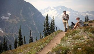 Hikers rest on Easy Pass in the North Cascades near Marblemount, Wash., in this undated photo.  Despite its name, this hike is a good workout but is easily one of the prettiest hikes in the North Cascades.(AP Photo/Seattle Times, Erika Schultz) SEATTLE OUT; USA TODAY OUT; MAGS OUT; TELEVISION OUT; NO SALES; MANDATORY CREDIT TO BOTH THE SEATTLE TIMES AND THE PHOTOGRAPHER