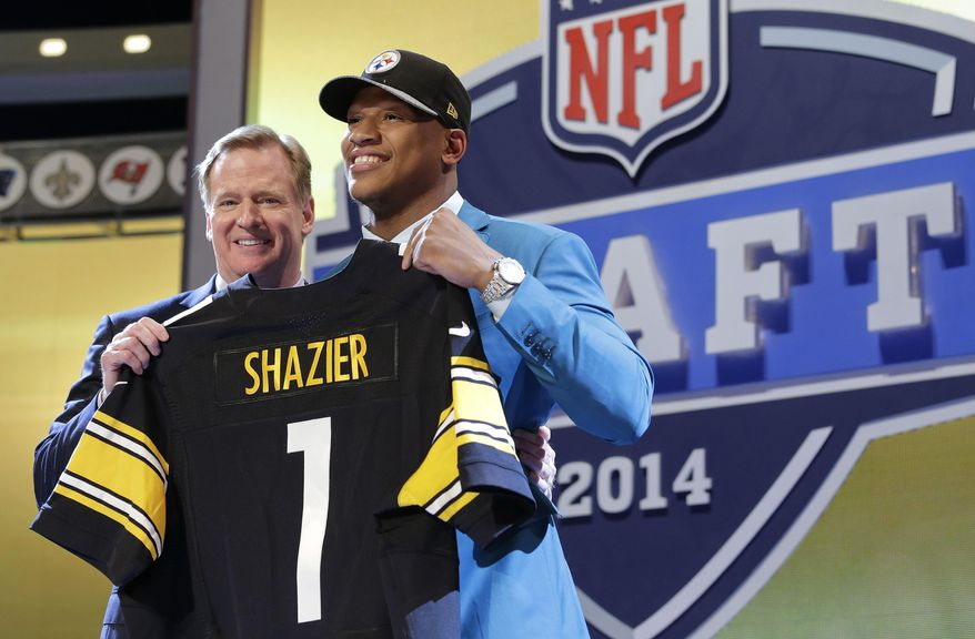 Ohio State outside linebacker Ryan Shazier poses with NFL commissioner Roger Goodell after being selected by the Pittsburgh Steelers as the 15th pick in the first round of the 2014 NFL Draft, Thursday, May 8, 2014, in New York. (AP Photo/Craig Ruttle)