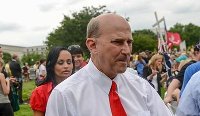 **FILE** Rep. Louie Gohmert, Texas Republican, leaves a tea party rally against the IRS at the U.S. Capitol in D.C. on June 19, 2013. (Andrew Harnik/The Washington Times)