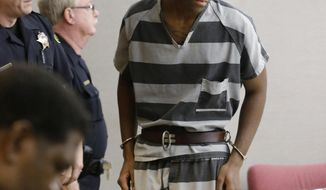 Sir Young, 20, is led into court before a hearing in Dallas Thursday, May 8, 2014.   A district court judge has reversed a previous order and imposed a series of probationary requirements for the 20-year-old man convicted of raping a schoolmate. The initial punishment for Young sparked a backlash when a prior judge in Dallas sentenced him to five years of probation and declined to impose standard conditions of probation for sex offenders. (AP Photo/LM Otero)