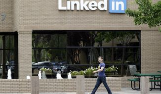 A man walks past the LinkedIn headquarters in Mountain View , Calif. on Thursday, May 8, 2014. (AP Photo/Marcio Jose Sanchez)