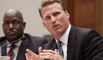 Former NFL player Patrick Eilers testifies at the House Committee on Education and Workforce on college athletes forming unions as Stanford Athletic Director Bernard Muir looks on, left, on May 8, 2014 on Capitol Hill in Washington. (AP Photo/Lauren Victoria Burke)