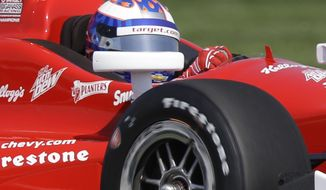 Scott Dixon, of New Zealand, drives through turn 13 during practice for the inaugural Grand Prix of Indianapolis IndyCar auto race at the Indianapolis Motor Speedway in Indianapolis, Thursday, May 8, 2014. (AP Photo/Michael Conroy)