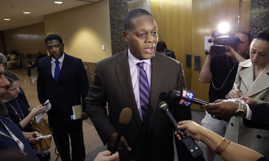 Dallas District attorney Craig Watkins speaks to reporters after a court hearing setting the probation conditions for Sir Young in Dallas Thursday, May 8, 2014.   A district court judge has reversed a previous order and imposed a series of probationary requirements for the 20-year-old man convicted of raping a schoolmate. The initial punishment for Young sparked a backlash when a prior judge in Dallas sentenced him to five years of probation and declined to impose standard conditions of probation for sex offenders. (AP Photo/LM Otero)