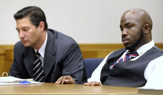 Johnathan Sails, right, sits with his defense attorney Robert Leonetti prior to the afternoon session on Thursday, May 8, 2014 in Eastpointe, Mich. Sails is charged with involuntary manslaughter in the drowning of a ninth-grader in a Detroit-area high school pool. Macomb County Prosecutor Eric Smith has said Sails was assigned to monitor a remedial swim class at East Detroit High School in November when students told him 14-year-old KeAir Swift was having trouble. Smith said Sails initially told students Swift was fooling around. He then changed clothing in a locker room before jumping into the pool. Swift was pulled out by a vice principal and died after several days on life support.  (AP Photo/Detroit News, Todd McInturf)  DETROIT FREE PRESS OUT; HUFFINGTON POST OUT