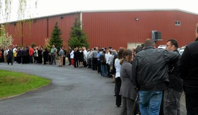 Mourners wait in line to enter Skate Time 209 in Accord, N.Y., on Thursday, May 8, 2014, to pay respects to the family of U.S. Army Sgt Farrell II. Farrell served in the 10th Mountain Division, joining the Army in 2008 after graduating from Rondout Valley High School. He is survived by his wife and parents. (AP Photo/The Daily Freeman, Tania Barricklo)