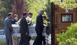 The casket containing the remains of former Rep. Jim Oberstar, D-Minn., is carried into Our Lady of Mercy Catholic Church for a Mass of Christian Burial, in Potomac, Md., Thursday, May 8, 2014. Oberstar served in the United States House of Representatives from 1975 to 2011 and died in his sleep at home in Potomac, Md., on May, 3, 2014.    He was 79-years old.   (AP Photo/Cliff Owen)