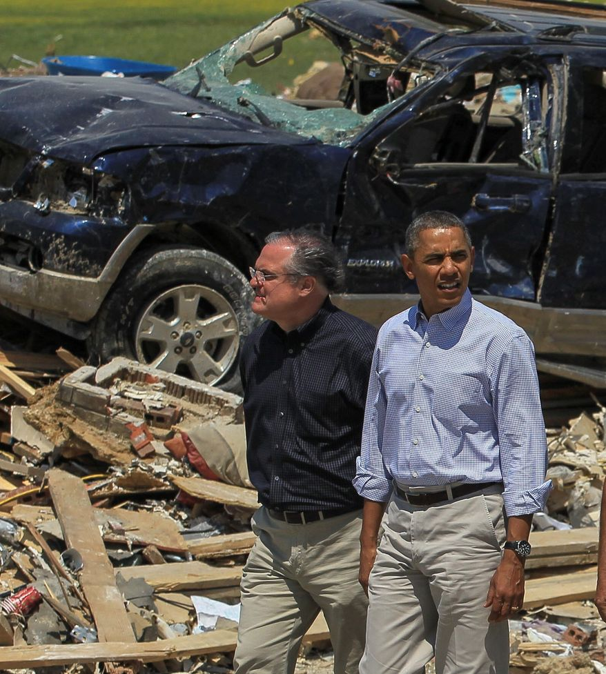 President Barack Obama walks with Sen. Mark Pryor while touring tornado-damaged areas of Vilonia, Ark., Wednesday, May 7, 2014. Surveying the remnants of nature's destructive power in the country's midsection, Obama pledged to residents of tornado-ravaged Arkansas communities that their government will stand with them until they finish rebuilding. (AP Photo/Arkansas Democrat-Gazette, Benjamin Krain, Pool)
