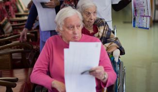 Elderly and disabled South African voters, assisted by nurses, cast their ballots during early voting for special groups at the Nazareth House old-age home in Johannesburg, South Africa Monday, May 5, 2014. South Africa goes to the polls on Wednesday, May 7, 2014 in elections that are likely to see the ruling African National Congress (ANC) party return to power with a smaller majority due to voters disaffected by corruption in government and economic inequality. (AP Photo/Ben Curtis)