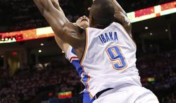 Los Angeles Clippers forward Blake Griffin  is fouled by Oklahoma City Thunder forward Serge Ibaka (9) in the first quarter of Game 2 of the Western Conference semifinal NBA basketball playoff series in Oklahoma City, Wednesday, May 7, 2014. (AP Photo/Sue Ogrocki)