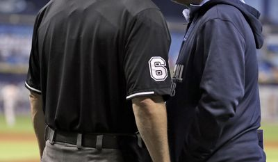 Tampa Bay Rays manager Joe Maddon, right, talks to home plate umpire Marty Foster after Foster ejected Rays pitching coach Jim Hickey during the first inning of a baseball game Thursday, May 8, 2014, in St. Petersburg, Fla. (AP Photo/Chris O'Meara)