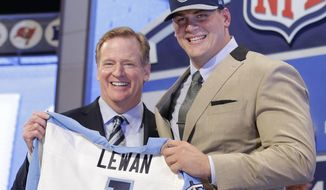 Michigan outside tackle Taylor Lewan poses for photos with NFL commissioner Roger Goodell after being selected by the Tennessee Titans as the eleventh pick in the the first round of the 2014 NFL Draft, Thursday, May 8, 2014, in New York. (AP Photo/Craig Ruttle)