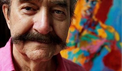 FILE - In this Aug. 31, 2007, file photo, artist LeRoy Neiman poses in his studio in New York. Neiman, who is best known for his colorful and energetic paintings of sporting events, died in 2012 at the age of 91. During a 40-year span, the celebrated sports artist created 139 illustrated baseballs for his friend Charlie McCabe, a bank marketing executive. The collection will be offered in a Heritage Auctions online sale on May 16, 2014. (AP Photo/Bebeto Matthews, File)