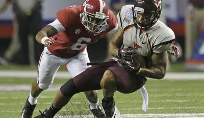 FILE - In this Aug. 31, 2013, file photo, Virginia Tech running back Trey Edmunds (14) is stopped by Alabama defensive back Ha Ha Clinton-Dix (6) in the second half of an NCAA college football game in Atlanta. During Clinton-Dix's first season as full-time starter he had 51 tackles and two interceptions. He is a top prospect in the upcoming NFL draft. (AP Photo/Dave Martin, File)
