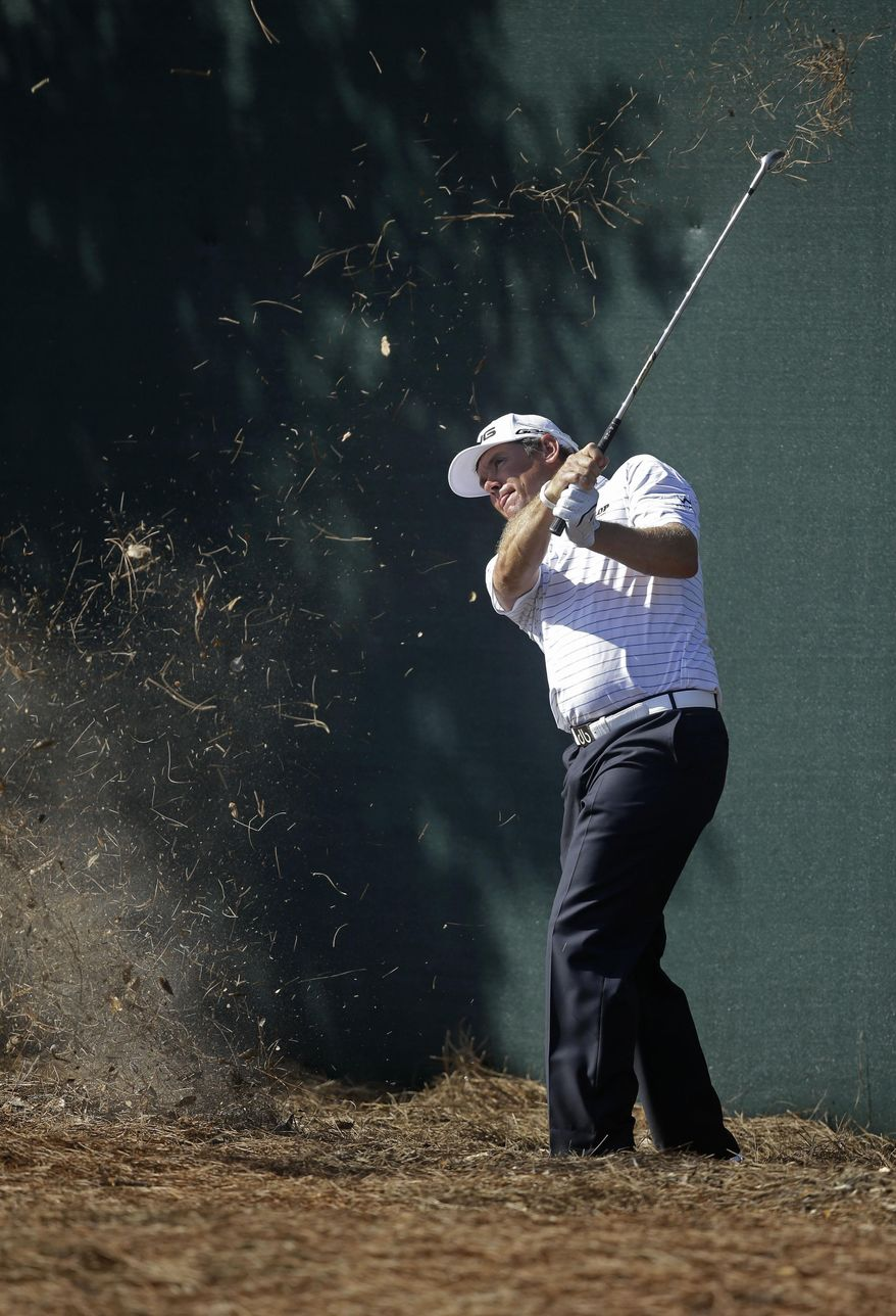 Lee Westwood of England, hits onto the ninth green during the first round of The Players championship golf tournament at TPC Sawgrass, Thursday, May 8, 2014 in Ponte Vedra Beach, Fla. (AP Photo/Gerald Herbert)