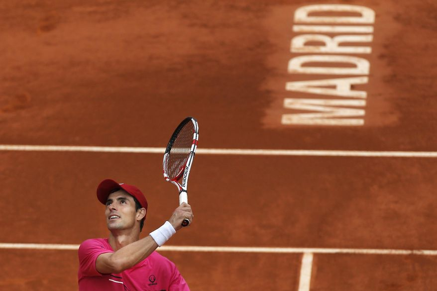 Santiago Giraldo from Colombia celebrates his victory during a Madrid Open tennis tournament match against Andy Murray from Britain in Madrid, Spain, Thursday, May 8, 2014. (AP Photo/Andres Kudacki)