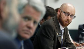 Rep. Jonathan Singer, D-Longmont, listens to discussion on a bill he sponsored which would allow marijuana dispensaries to form financial co-operatives, at the Colorado Legislature, in Denver, Wednesday, May 7, 2014. Colorado lawmakers have approved the world's first financial system for the marijuana industry, a network of uninsured cooperatives designed to give pot businesses a way to access basic banking services. The plan, approved Wednesday, seeks to move the marijuana industry away from its cash-only roots. (AP Photo/Brennan Linsley)