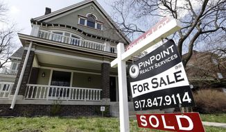 "FILE - In this Tuesday, April 9, 2013 file photo, a ""Sold"" sign is posted outside a home in Indianapolis. Mortgage giant Freddie Mac reports quarterly results for the January-March 2014 quarter on Thursday, May 8, 2014. (AP Photo/Michael Conroy, File)"