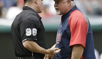 Minnesota Twins manager Ron Gardenhire, right, argues with home plate umpire Chris Segal in the third inning of a baseball game against the Cleveland Indians, Thursday, May 8, 2014, in Cleveland. (AP Photo/Tony Dejak)