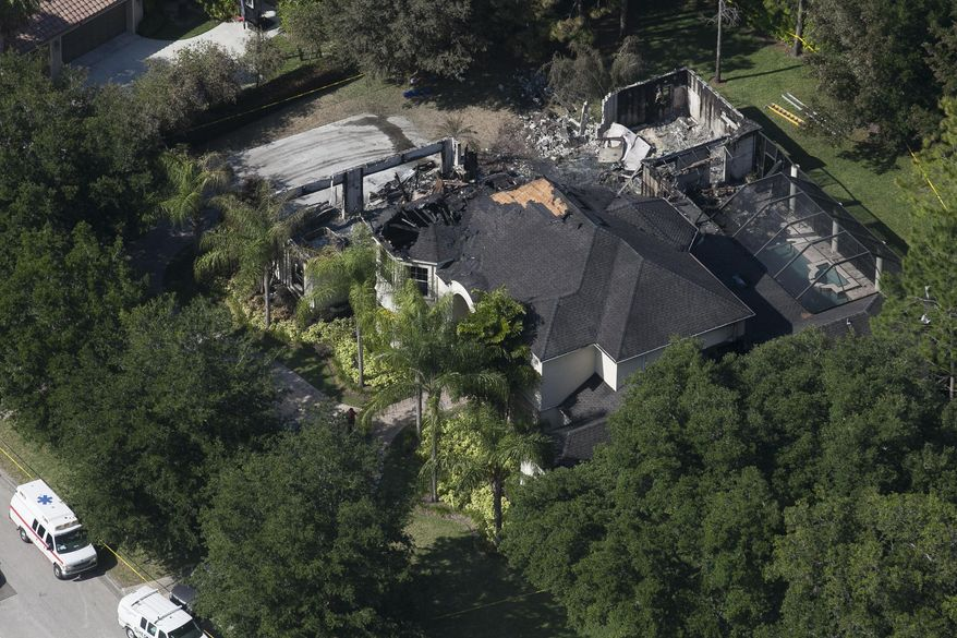 This aerial photo shows the burned out home on Thursday, May 8, 2014 in Tampa, Fla.  Authorities have said they think the fire at the five-bedroom home was intentionally set and that they found fireworks inside the home. Police have not said how the blaze started or who might be responsible. The home, which is owned by former tennis star James Blake, was engulfed in flames when firefighters responded Wednesday morning. (AP Photo/The Tampa Bay Times, Eve Edelheit)