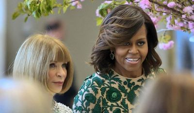 First lady Michelle Obama, right, and Vogue editor Anna Wintour appear at a dedication ceremony for the Anna Wintour Costume Center, Monday, May 5, 2014, at the Metropolitan Museum of Art in New York. (AP Photo/Bebeto Matthews)