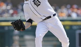 Detroit Tigers starting pitcher Drew Smyly throws during the first inning of a baseball game against the Houston Astros in Detroit, Thursday, May 8, 2014. (AP Photo/Carlos Osorio)