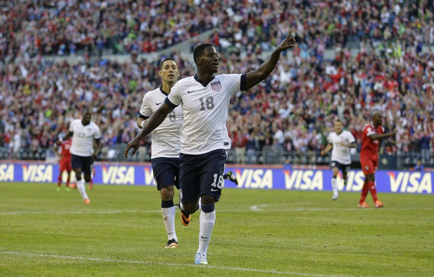 USA's Eddie Johnson, right, and Clint Dempsey, left, celebrate after Johnson scored a goal against Panama during World Cup qualifier soccer match, Tuesday, June 11, 2013, in Seattle. (AP Photo/Ted S. Warren)